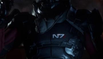 Gros plan sur le logo N7. Il s'agit donc bien d'un humain, et soldat de l'Alliance qui plus est.